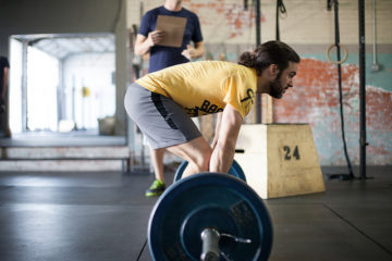 Man Deadlifts in a CrossFit worktout