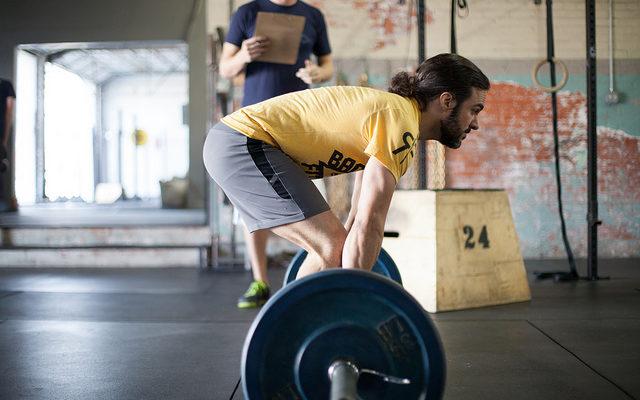 Man Deadlifts in a CrossFit worktout